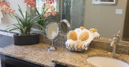 vanity: Bathroom counter top and mirror