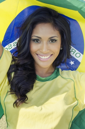 Beautiful young woman wearing Brazil national colo Stock Photo