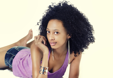 Attractive young woman with curtly frizzy long hair photo