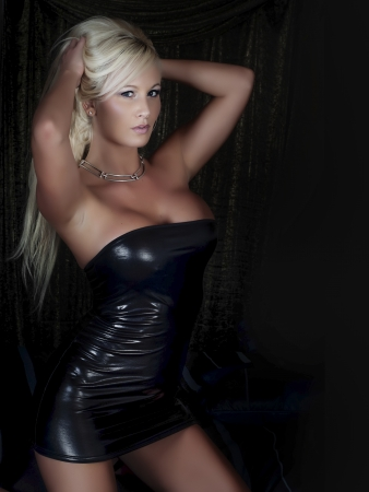 Sexy blonde woman in black rubber dress photo