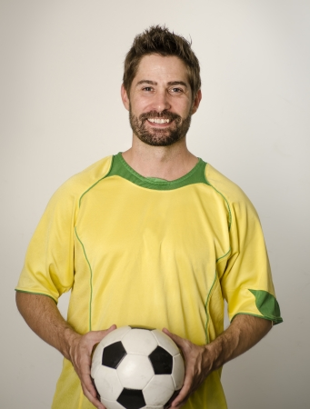 Man smiling wearing green soccer football athletic sport top, coach, sport picture  photo