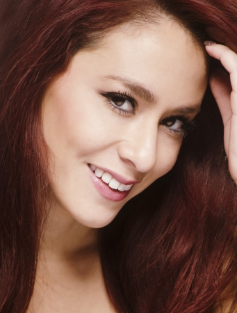 Smiling happy beautiful young woman with red hair photo