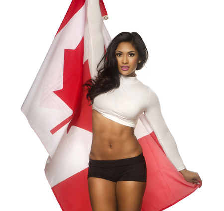 studio portrait: Beautiful woman holding Canada flag