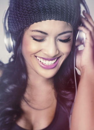 Beautiful young woman happy listening to music photo