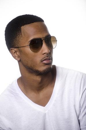 Fashionable stylish young man wearing sunglasses photo