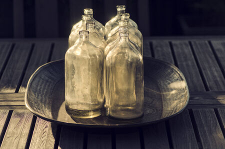 Antique collection of glass bottles outdoor stylish decor photo