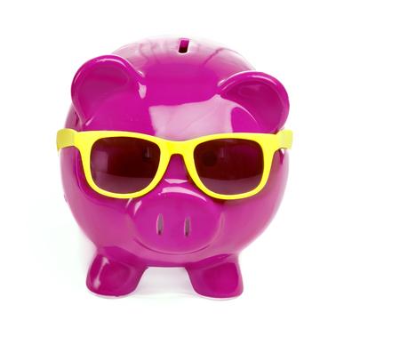 Saving for holiday - piggy bank wearing sunglasses photo