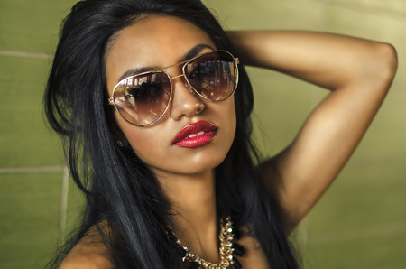Beautiful young woman wearing sunglasses Stock Photo