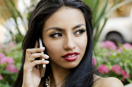 Beautiful young woman holding cell phone photo