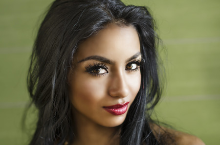 eye red: Beautiful face of exotic young woman Stock Photo