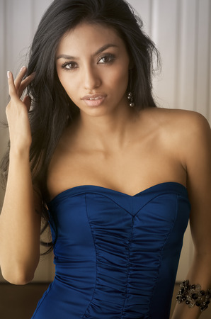 Beautiful young woman in blue dress photo