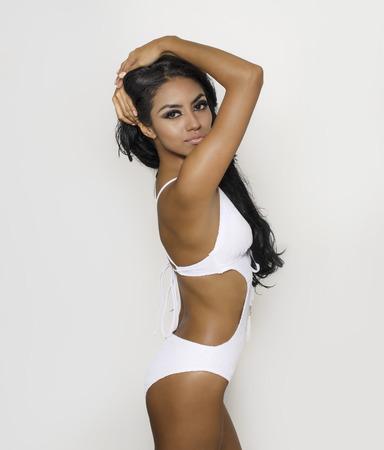 photo studio: Beautiful young woman wearing white swimsuit