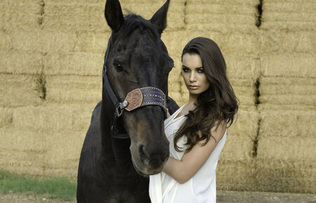 Beautiful young woman and her horse photo