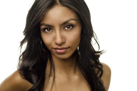 Beautiful young woman with dark long hair photo