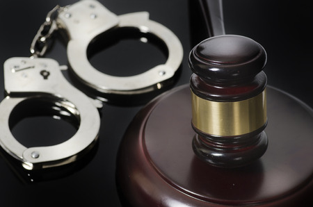 arrested criminal: Law legal concept photo of gavel and hand cuffs