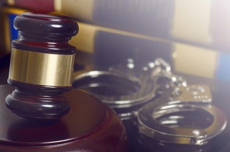 Law legal concept photo of gavel books hand cuffs