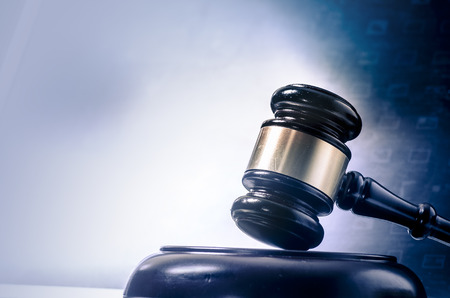 Law legal concept photo of gavel on computer photo