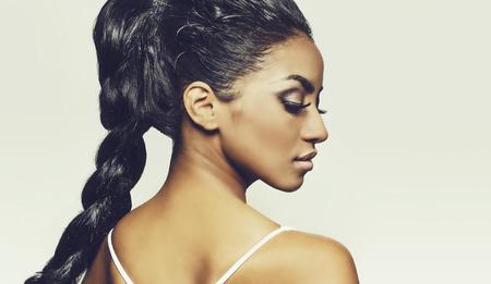 Profile of beautiful woman face braided hair Standard-Bild