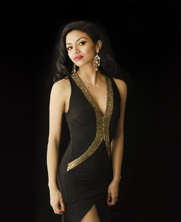 american sexy: Beautiful young woman in black dress Stock Photo