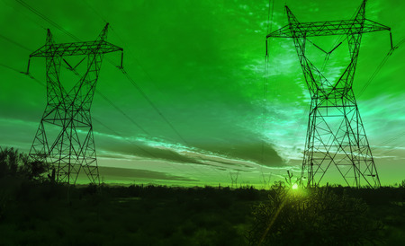 Pylon and transmission power line in sunset  Stock Photo: photo