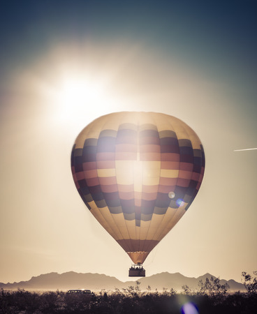 arizona sunset: Hot air balloon ride over Arizona desert Stock Photo