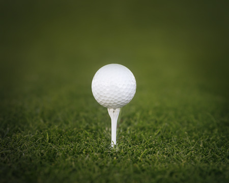 Golf ball on tee ready to be shot