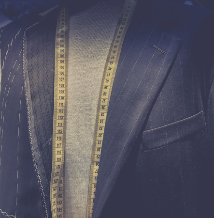 Taylor made men\'s designer suit - tape measure 스톡 콘텐츠