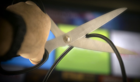 scissor cut: Cutting the cable on TV - concept image