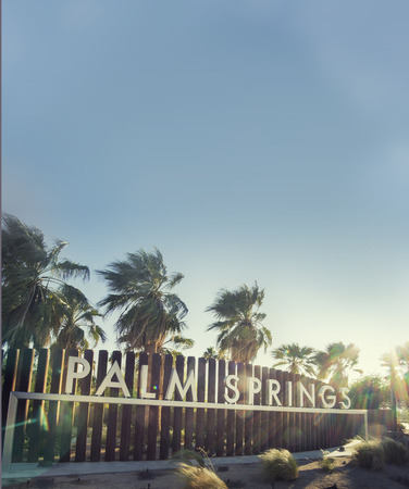 hot spring: Palm Springs sign  epic sky and sunflare copy space area