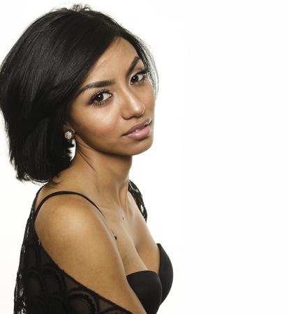 beautiful black woman: Beautiful young woman wearing black dress outdoor