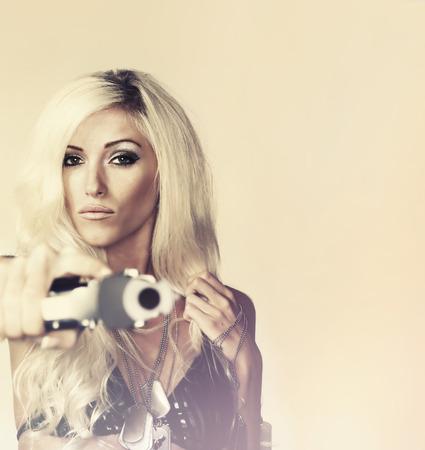 holding gun: Beautiful woman holding gun Stock Photo
