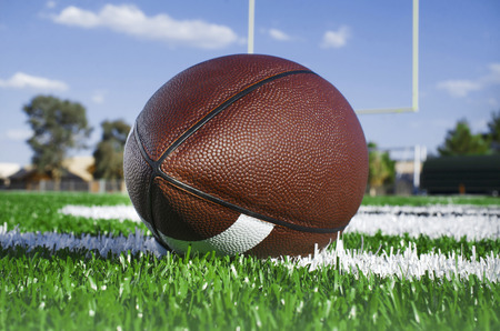 American football on find with goal posts