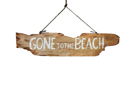 hand carved: Gone to the Beach hand carved sign - holiday vacation concept image.