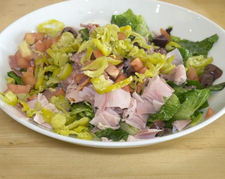 kalamata: Mediterranean salad with kalamata olives, pastrami and peppers.