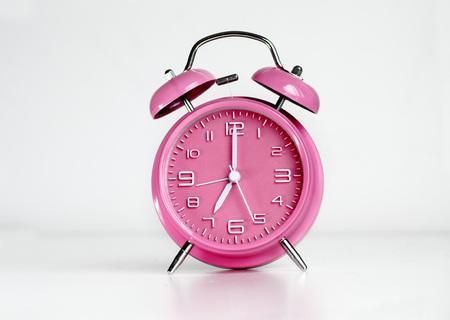 Pink analog retro twin bell alarm clock Imagens