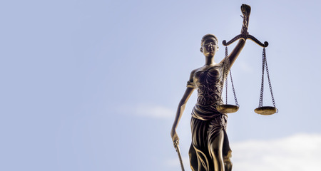 Scales of Justice symbol - legal law concept image. Standard-Bild