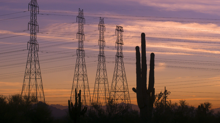 powers: Desert sunset power electricity pylons on beautiful Arizona evening Stock Photo