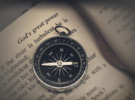 Bible on compass - religion faith concept image Stock Photo
