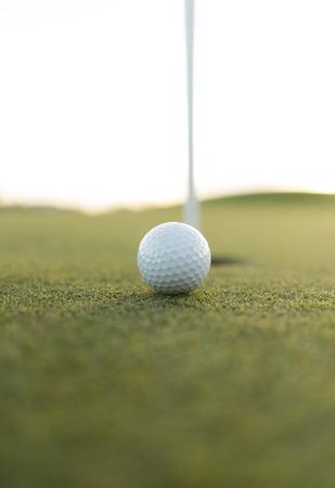 caddie: golf ball close to cup hole