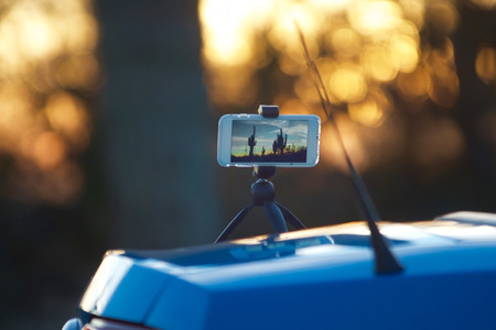 timelapse: Taking photo with smart phone time-lapse Stock Photo