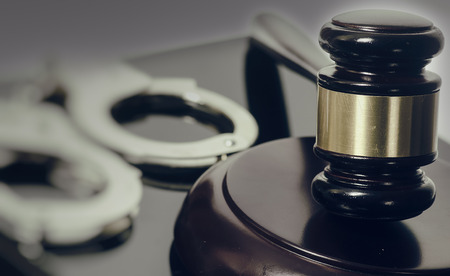 Legal law concept image - gavel and handcuffs Stock Photo