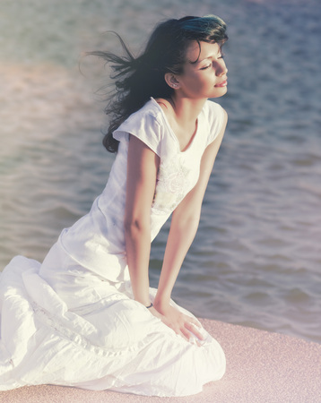 blissful: Beautiful young woman in blissful serene relaxed pose Stock Photo