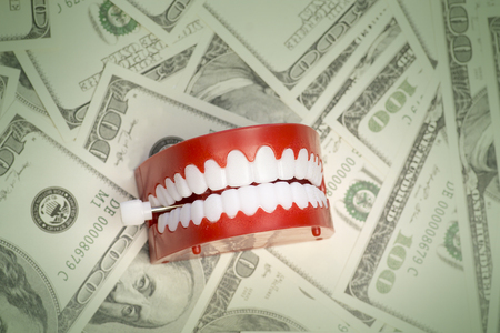 Cost of having a healthy happy smile concept image Stock fotó