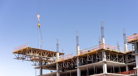 floor level: New construction, crane lifting new floor level