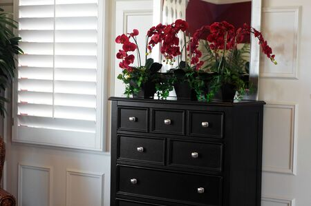 window treatments: Window treatment shutters in bedroom. Stock Photo