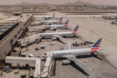 american airlines: American Airlines parked at Phoenix SkyHarbor Airport.  May 28th 2016.  (Reuters) - Airport screenings caused more than 70,000 American Airlines customers to miss their flights in 2016. Editorial
