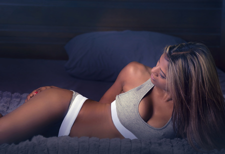 Beautiful exotic young woman sports underwear