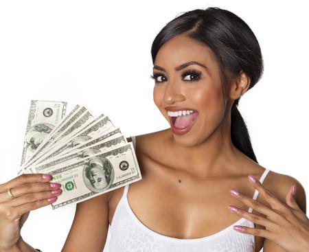 Beautiful woman holding money hundred dollar bills