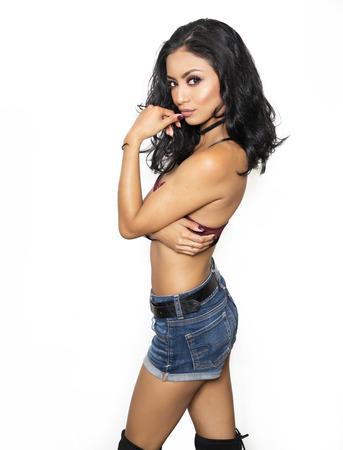 latina girl: Beautiful exotic young woman in denim shorts