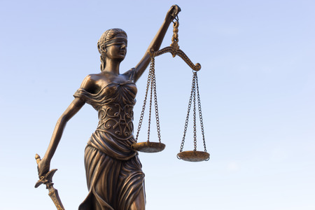 bronze background: Scales of Justice symbol - legal law concept image